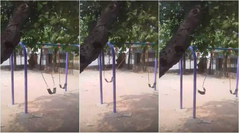 A swing swinging on their own in a mysterious video