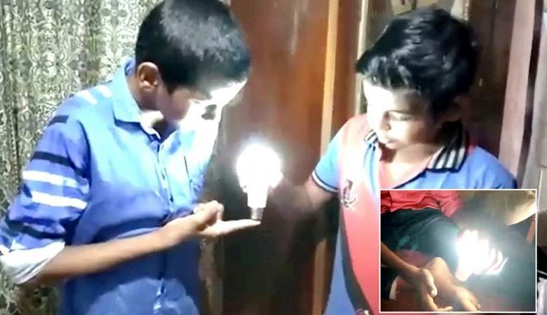 The boy lights up the LED lamps with a touch of his hand
